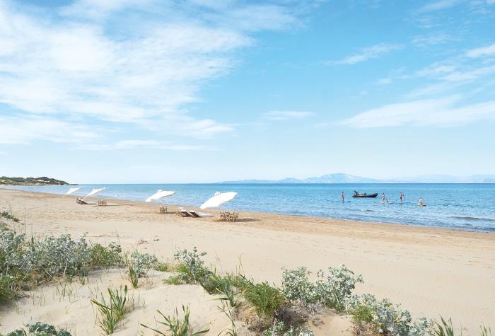02-sandy-blue-flag-beach-in-mega-resort-grecotel-riviera-olympia-in-greece